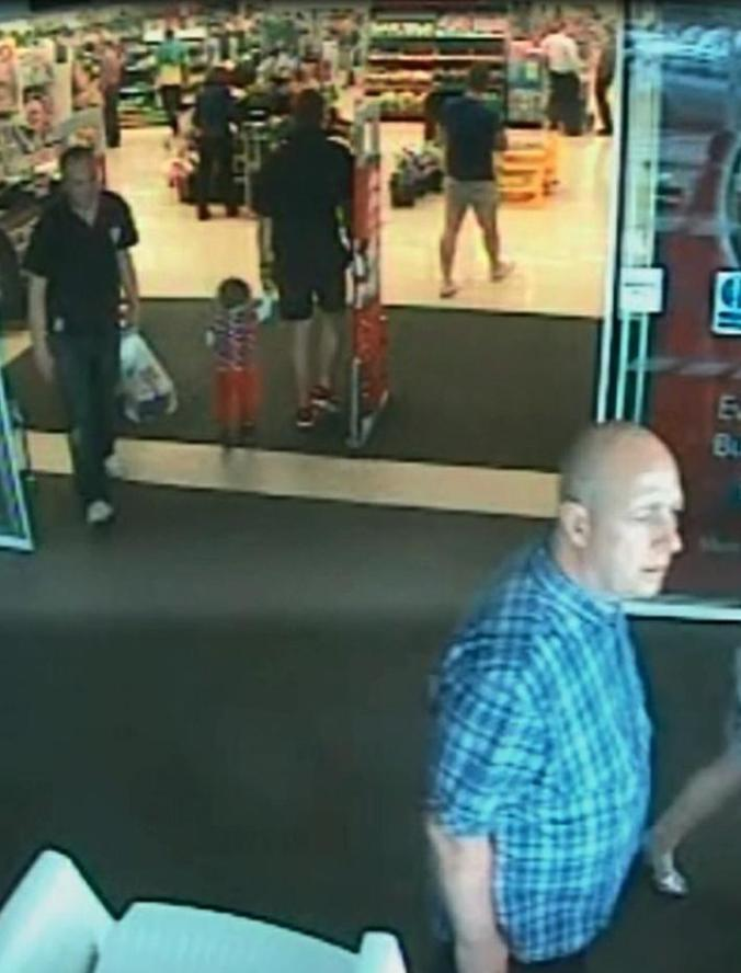 In this image made available by South Wales Police shows a video image Alan Knight,of Swansea south Wales, right, in a supermarket in Bishopís Cleeve in western England in June 2014. Alan Knight a fraudster who pretended to be quadriplegic and sometimes comatose for two years to avoid prosecution has been convicted after police caught him on camera driving and strolling around supermarkets. Alan Knight of Swansea, Wales, stole more than 40,000 pounds ($64,000) from the bank account of an elderly neighbor with Alzheimer's disease, prosecutors said. (AP Photo/South Wales Police)